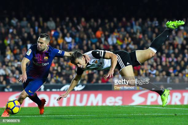 Jordi Alba of FC Barcelona competes for the ball with Gabriel Paulista of Valencia CF during the La Liga match between Valencia and Barcelona at...