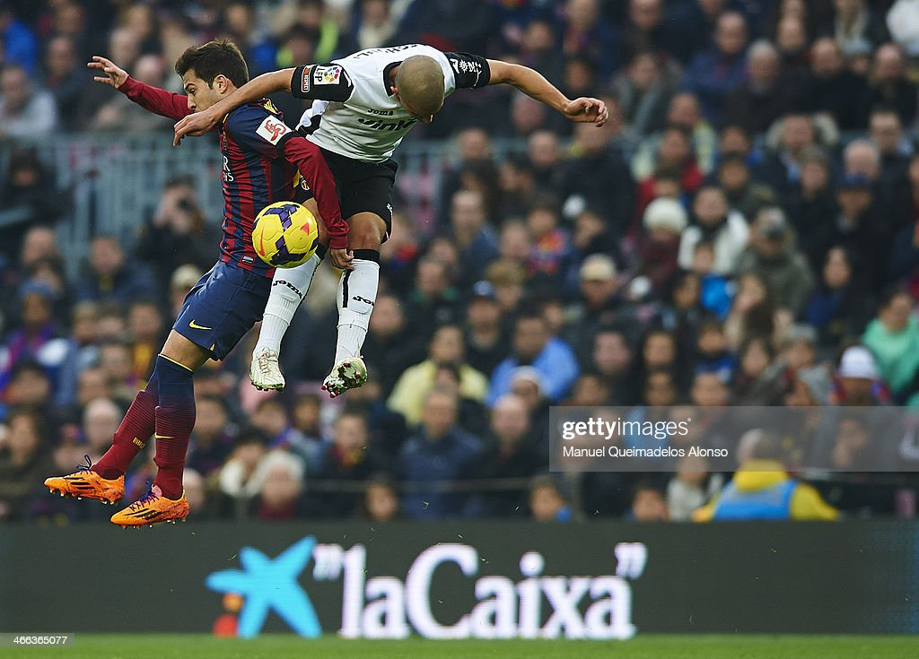 Jordi Alba of FC Barcelona competes for the ball with Sofiane Feghouli (L) of Valencia CF during the La Liga match between FC Barcelona and Valencia CF at Camp Nou on February 1, 2014 in Barcelona, Spain.