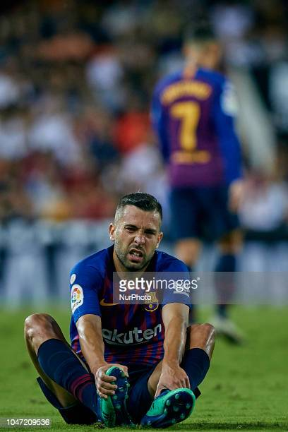 Jordi Alba of FC Barcelona lays on the pitch during the La Liga match between Valencia CF and FC Barcelona at Mestalla on October 7 2018 in Valencia...