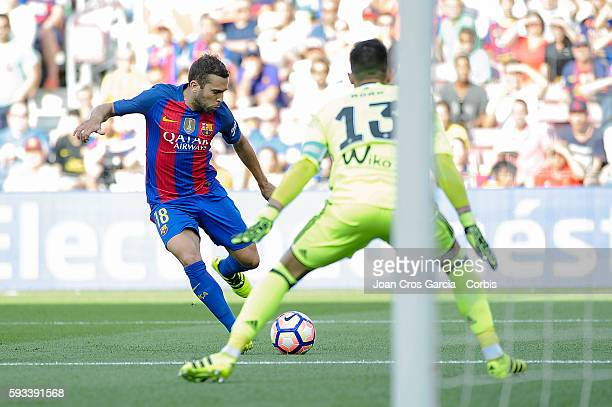 Jordi Alba of FC Barcelona looks to shoot past Adán the captain of Real Betis during the Spanish League match between FC Barcelona vs Real Betis...