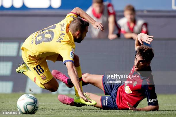 Jordi Alba of FC Barcelona Nacho Vidal of CA Osasuna during the La Liga Santander match between Osasuna v FC Barcelona at the Estadio El Sadar on...