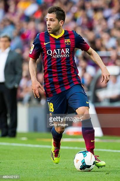 Jordi Alba of FC Barcelona runs with the ball during the La Liga match between FC Barcelona and CA Osasuna at Camp Nou on March 16 2014 in Barcelona...