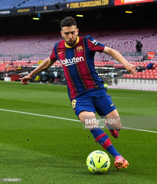 Jordi Alba of FC Barcelona runs with the ball during the La Liga Santander match between FC Barcelona and RC Celta at Camp Nou on May 16, 2021 in...