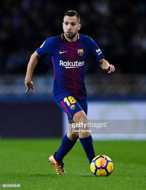 Jordi Alba of FC Barcelona runs with the ball during the La Liga match between Real Sociedad and FC Barcelona at Anoeta stadium on January 14 2018 in...