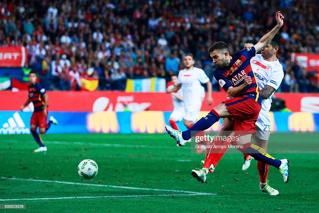 Jordi Alba of FC Barcelona scores their opening goal during the Copa del Rey Final match between FC Barcelona and Sevilla FC at Vicente Calderon Stadium on May 22, 2016 in Madrid, Spain.