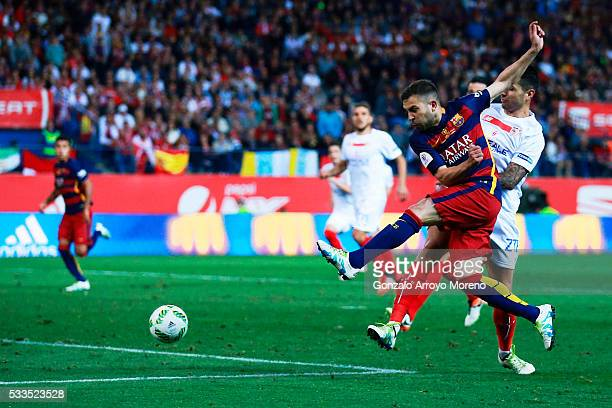 Jordi Alba of FC Barcelona scores their opening goal during the Copa del Rey Final match between FC Barcelona and Sevilla FC at Vicente Calderon...