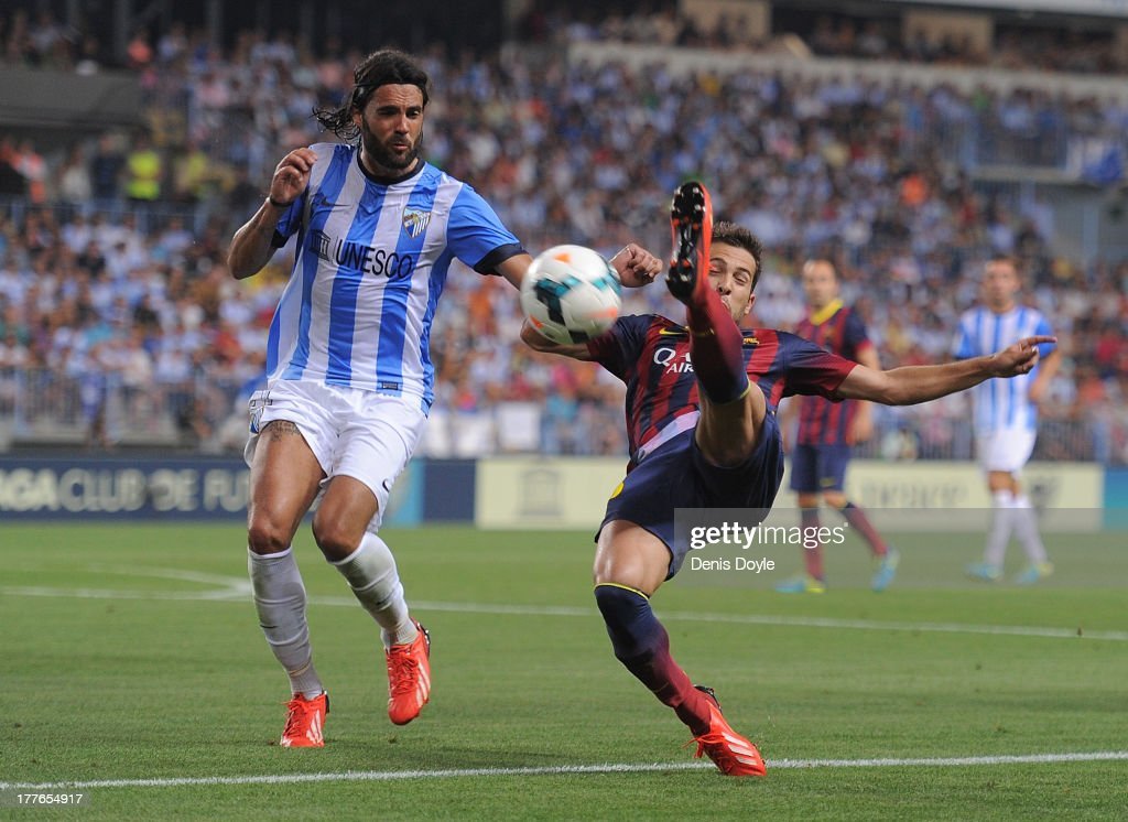 ;Jordi Alba (R) of FC Barcelona tries an overhead kick beside Sergio Sanchez of Malaga CF during the La Liga match between Malaga CF and FC Barcelona at La Rosaleda Stadium on August 25, 2013 in Malaga, Spain.