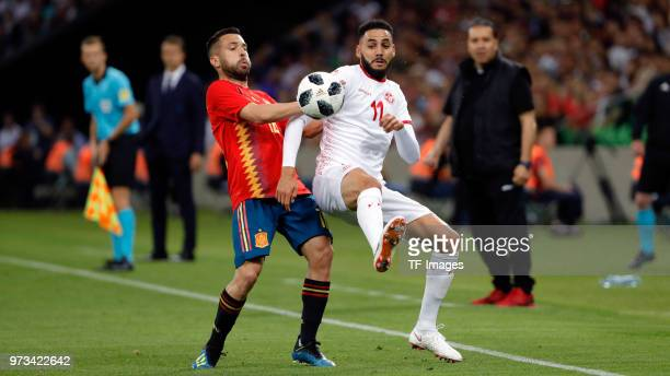 Jordi Alba of Spain and Dylan Bronn of Tunisia battle for the ball during the friendly match between Spain and Tunisia at Krasnodar's stadium on June...