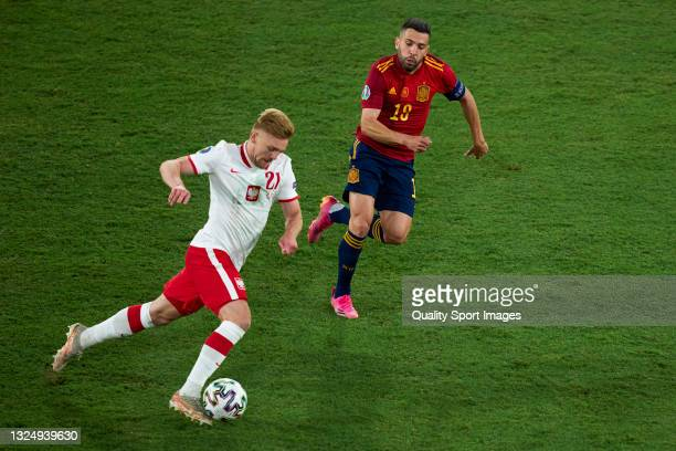 Jordi Alba of Spain battle for the ball with Kamil Jozwiak of Poland during the UEFA Euro 2020 Championship Group E match between Spain and Poland at...