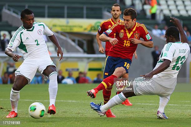Jordi Alba of Spain beats the Nigeria defence to score their first goal during the FIFA Confederations Cup Brazil 2013 Group B match between Nigeria...