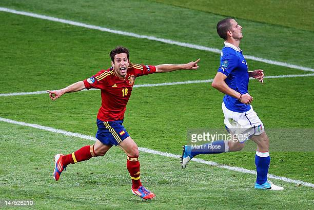 Jordi Alba of Spain celebrates next to Leonardo Bonucci of Italy after scoring his team's second goal during the UEFA EURO 2012 final match between...