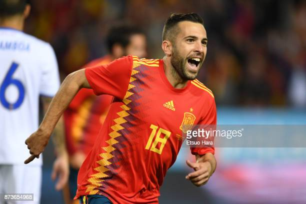 Jordi Alba of Spain celebrates scoring his side's opening goal during the international friendly match between Spain and Costa Rica at La Rosaleda...