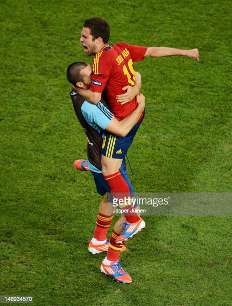 Jordi Alba of Spain celebrates with Alvaro Negredo after the first goal scored by Xabi Alonso during the UEFA EURO 2012 quarter final match between...