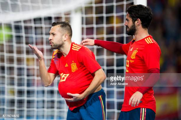 Jordi Alba of Spain celebrates with his teammate Isco Alarcon of Spain after scoring the opening goal during the international friendly match between...