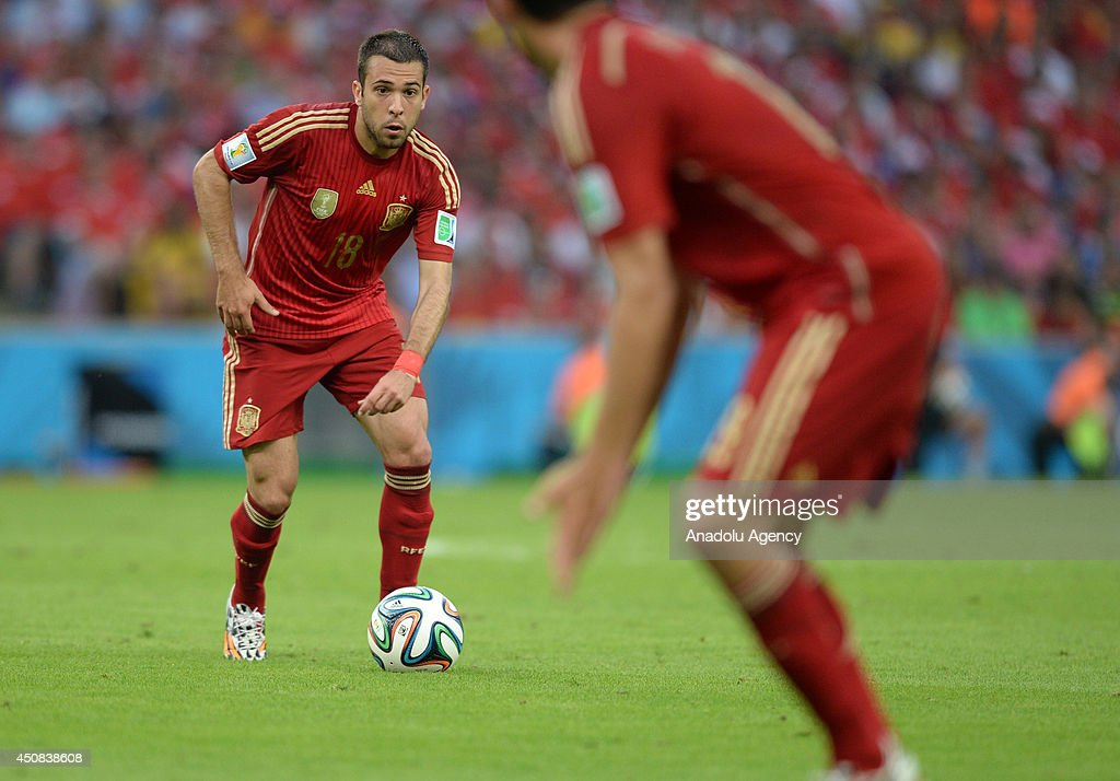 Jordi Alba (18) of Spain challenges during the 2014 FIFA World Cup Group B soccer match between Spain and Chile at the Maracana Stadium in Rio de Janeiro, Brazil, on June 18, 2014.