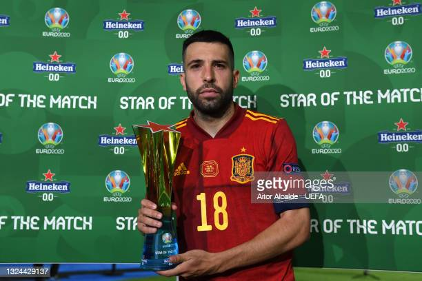 """Jordi Alba of Spain poses for a photograph with their Heineken """"Star of the Match"""" award after the UEFA Euro 2020 Championship Group E match between..."""