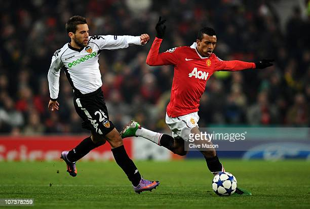 Jordi Alba of Valencia competes with Nani of Manchester United during the UEFA Champions League Group C match between Manchester United and Valencia...