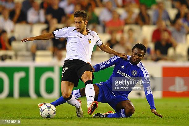 Jordi Alba of Valencia is tackled by Jon Obi Mikel of Chelsea during the UEFA Champions League Group E match between Valencia CF and Chelsea at the...