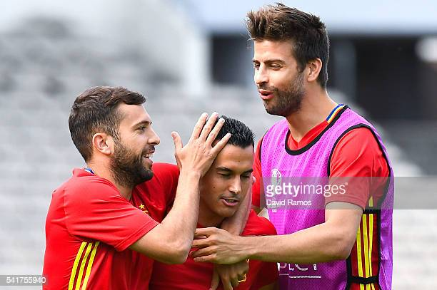 Jordi Alba Pedro Rodriguez and Gerard Pique of Spain share a joke during a training session ahead of their UEFA Euro 2016 Group D match against...