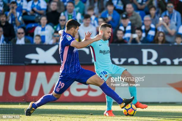 Jordi Alba Ramos of FC Barcelona fights for the ball with Ezequiel Matias Munoz of CD Leganes during the La Liga 201718 match between CD Leganes vs...
