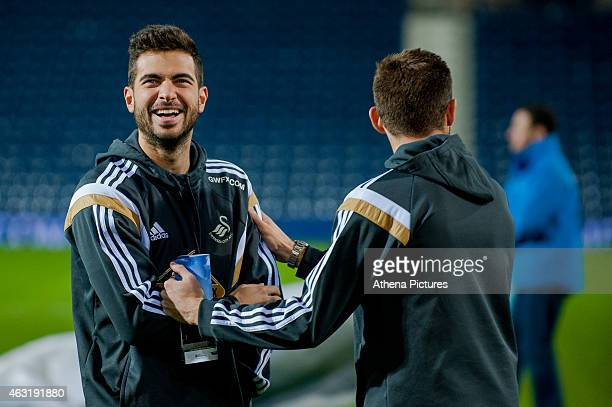 Jordi Amat and Angel Rangel of Swansea City share a joke on the pitch prior to the Premier League match between West Bromwich Albion and Swansea City...