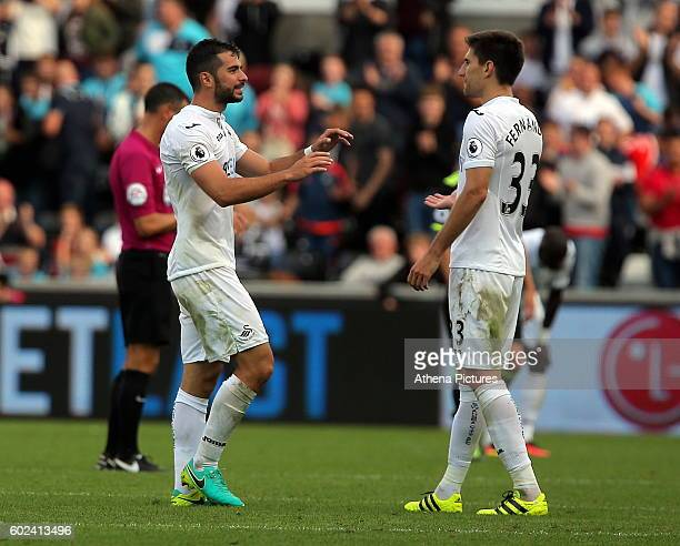 Jordi Amat and team mate Federico Fernandez of Swansea City congratulate each other after the Premier League match between Swansea City and Chelsea...