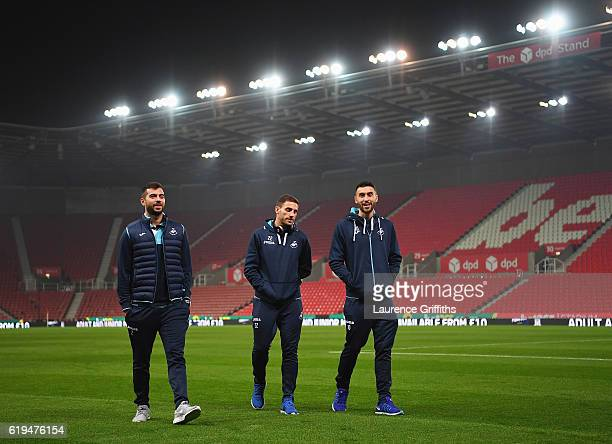 Jordi Amat Angel Rangel and Borja Gonzalez of Swansea City walk on the pitch prior to the Premier League match between Stoke City and Swansea City at...