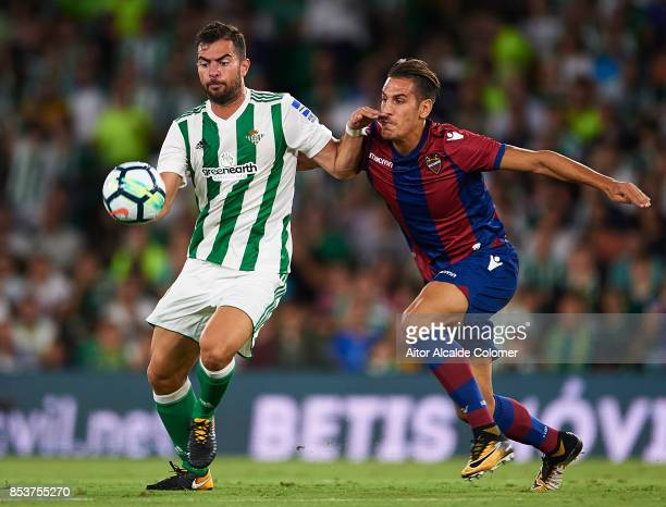 Jordi Amat of Real Betis Balompie competes for the ball with Alex Alegria of Levante UD during the La Liga match between Real Betis and Levante at...