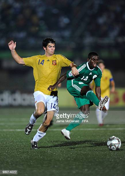 Jordi Amat of Spain battles with Sani Emmanuel of Nigeria during the FIFA U17 World Cup SemiFinal 2 between Spain and Nigeria at the Teslim Balogun...