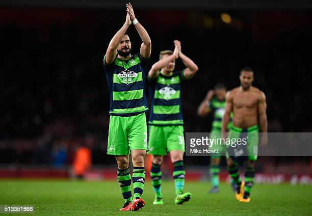 Jordi Amat of Swansea City applauds the crowd after victory in the Barclays Premier League match between Arsenal and Swansea City at the Emirates...