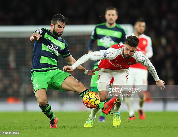 Jordi Amat of Swansea City challenges Olivier Giroud of Arsenal for the ball during the Barclays Premier League match between Arsenal and Swansea...