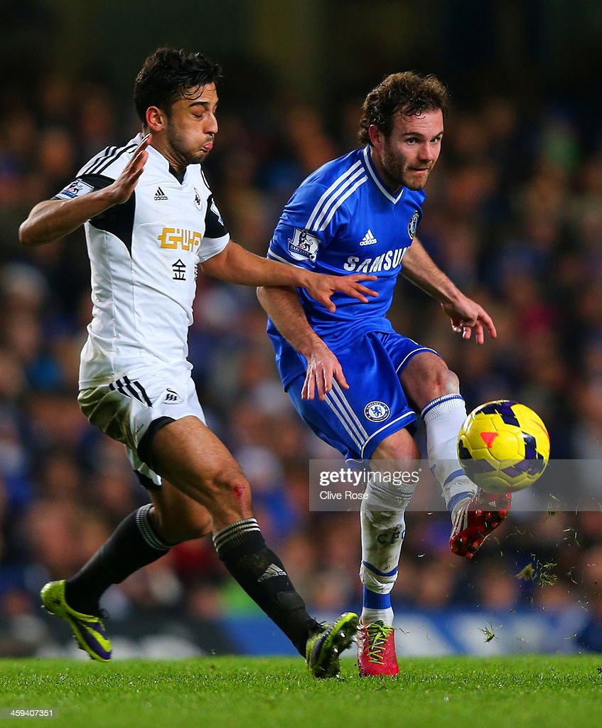 Jordi Amat of Swansea City closes down Juan Mata of Chelsea during the Barclays Premier League match between Chelsea and Swansea City at Stamford Bridge on December 26, 2013 in London, England.