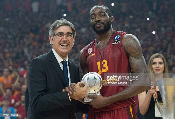 Jordi Bertomeu CEO and president of Euroleague Basketball gives to Stephane Lasme #13 of Galatasaray Odeabank Istanbul after the EuroCup Basketball...
