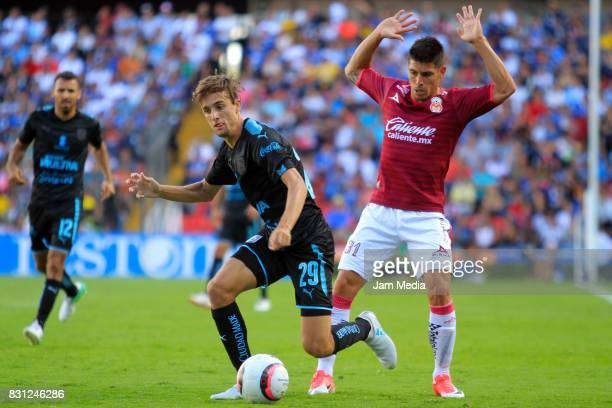 Jordi Cortizo of Queretaro and Gaston Lezcano of Morelia during the 4th round match between Queretaro and Morelia as part of the Torneo Apertura 2017...