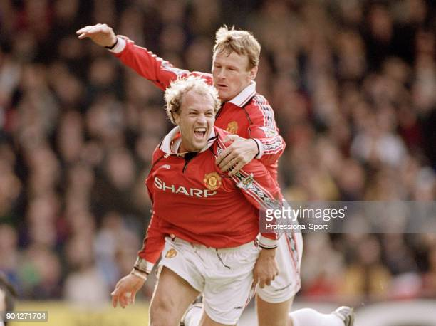 Jordi Cruyff of Manchester United celebrates with teammate Teddy Sheringham after scoring during the FA Carling Premiership match between Wimbledon...