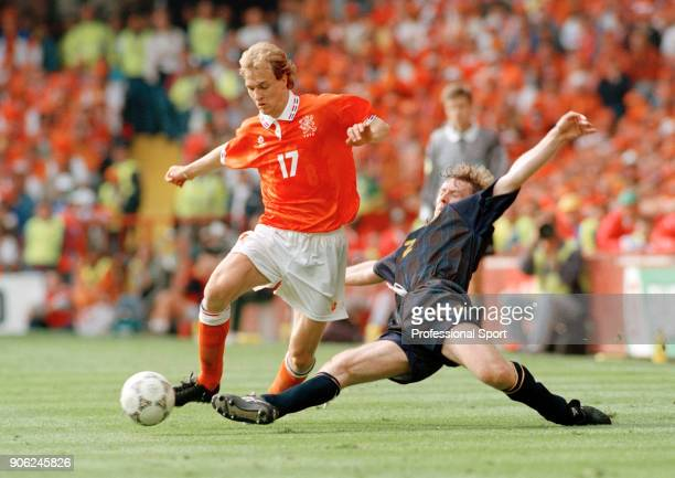 Jordi Cruyff of the Netherlands beats Stewart McKimmie of Scotland during their UEFA Euro96 Group A match at Villa Park in Birmingham on 10th June...