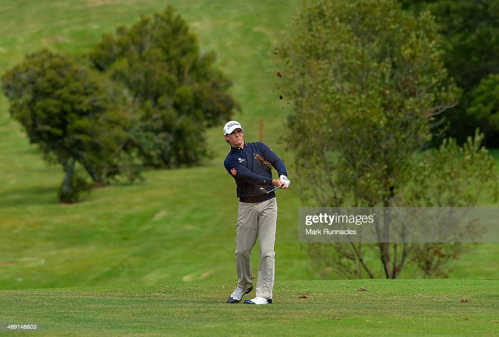 Jordi Garcia Pinto of Portugal plays his approach shot to the 15th green during the Madeira Islands Open - Portugal - BPI at Club de Golf do Santo da Serra on May 10, 2014 in Funchal, Madeira, Port gal.