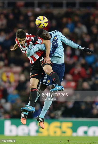 Jordi Gomez of Sunderland and Cheikhou Kouyate of West Ham compete for a header during the Barclays Premier League match between Sunderland and West...