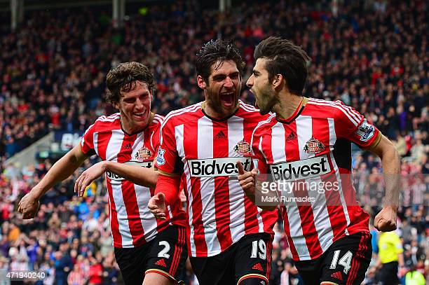 Jordi Gomez of Sunderland celebrates his penalty with Danny Graham and Billy Jones during the Barclays Premier League match between Sunderland and...