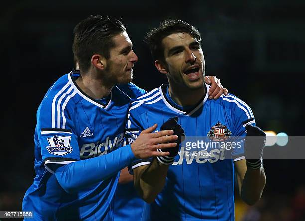 Jordi Gomez of Sunderland celebrates scoring his penalty with Liam Agnew of Sunderland during the FA Cup Fourth Round Replay match between Fulham and...