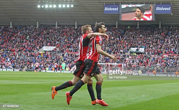 Jordi Gomez of Sunderland celebrates with Seb Larsson after scoring the second Sunderland goal during the Barclays Premier League match between...