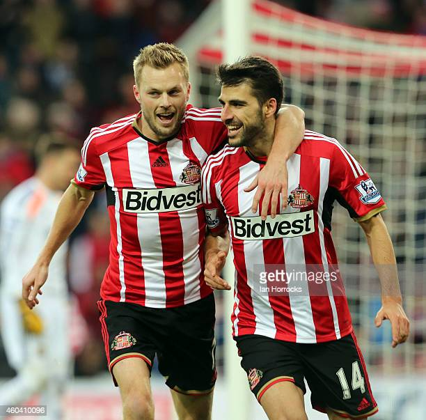 Jordi Gomez of Sunderland celebrates with Sebastian Larsson after scoring the opening goal during the Barclays Premier League match between...