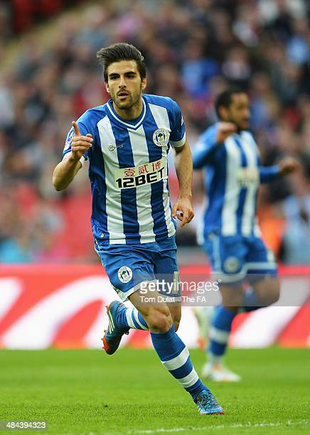 Jordi Gomez of Wigan Athletic celebrates after scoring a goal from the penalty spot during the FA Cup Semi-Final match between Wigan Athletic and...