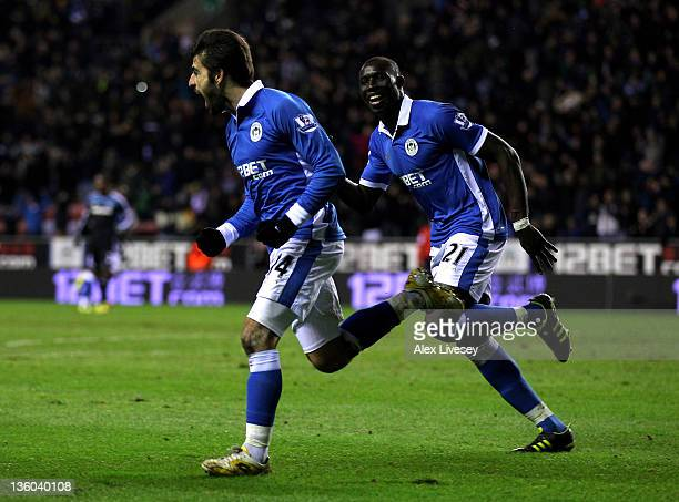 Jordi Gomez of Wigan Athletic celebrates scoring an equalising goal with team mate Mohamed Diame during the Barclays Premier League match between...