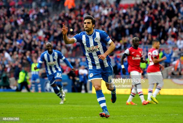 Jordi Gomez of Wigan Athletic celebrates scoring from the penalty spot during the FA Cup SemiFinal match between Wigan Athletic and Arsenal at...