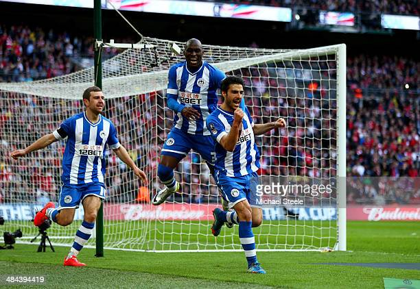 Jordi Gomez of Wigan Athletic celebrates scoring from the penalty spot with Marc-Antoine Fortune and James McArthur of Wigan Athletic during the FA...