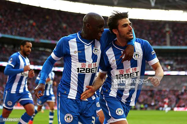 Jordi Gomez of Wigan Athletic celebrates scoring from the penalty spot with MarcAntoine Fortune of Wigan Athletic during the FA Cup SemiFinal match...