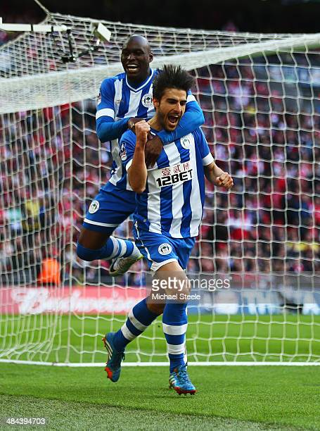 Jordi Gomez of Wigan Athletic celebrates scoring from the penalty spot with Marc-Antoine Fortune of Wigan Athletic during the FA Cup Semi-Final match...