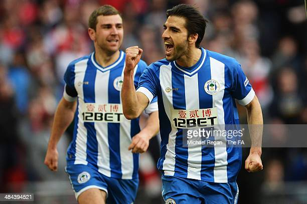 Jordi Gomez of Wigan Athletic celebrates with team-mate James McArthur after scoring a goal from the penalty spot during the FA Cup Semi-Final match...
