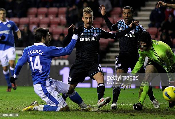Jordi Gomez of Wigan Athletic scores an equalising goal during the Barclays Premier League match between Wigan Athletic and Chelsea at the DW Stadium...